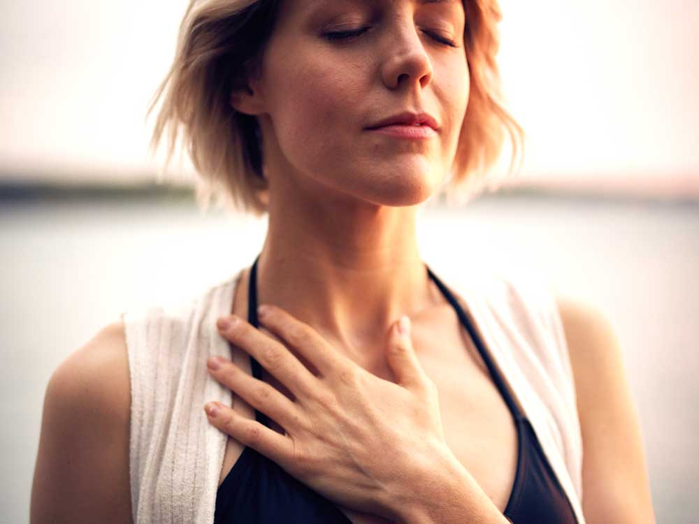 practice breathing woman for coronavirus anxiety relieve